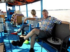 Relax on boat while cruising along Mekong river